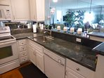 stainless steel sink and and granite counter tops
