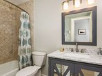 Beautiful finishes, tub and shower await you in the upstairs bath located across the hall from the bunk room.