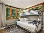 This guest room with a queen twin bunk offers great bedding for your group.
