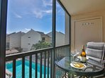 The screened balcony has a lovely view of the heated community pool.  Enjoy your wine with a lovely view.