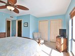 Master bedroom has natural light with a pool view, queen bed and en-suite bath.