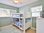 Third bedroom has lots of natural light.  Bunk beds for the kids.