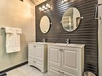A full en-suite bathroom with double sinks finishes off the room.