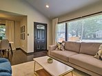 Large windows flood the open-concept layout with warm natural lighting.