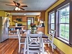 Enjoy meals family-style at the 4-person dining table.