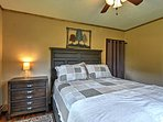 Two private bedrooms host queen-sized beds for 4 guests.