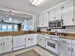 The full kitchen is very functional, and the open floor plan allows means that preparing dinner won't split up the...