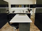 Cook in the fully equipped kitchen and enjoy eating at the large breakfast bar.