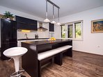 Kitchen with dining area suitable for 8 persons