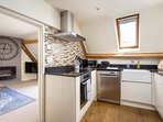 The well presented kitchen is perfect for two guests