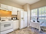 Modern appliances and ample counter space make home-cooking a breeze.