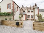 4 SPITTAL FARM, woodburner, exposed beams, ideal for families, in Wigton