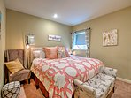2 guests can sleep in this king bed in the basement suite bedroom.