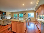 The fully equipped kitchen boasts stainless steel appliances.