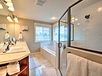 A jetted tub and spacious walk-in shower highlight the master en-suite bathroom.
