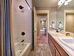 Rinse off in the second bathroom offersing a shower/tub combo.