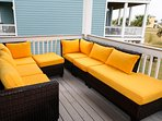 Large deck offers plenty of comfy seating to enjoy the view and ocean breeze.