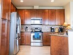 Gourmet fully-equipped kitchen with Granite, S/S appliances, dishwasher, large french-door fridge.