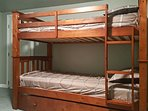 The room boasts 2 twin-over-twin bunk beds.