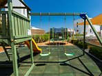 Communal playground area with toys, ping pong table and trampoline