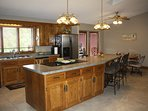 Full kitchen with oak cabinets. Plenty of pots and pans, dishes and utensils for you to use.