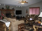 Upstairs living room has 2 couches and a love seat with a large screen tv.