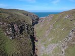 Drone shot of gorge with secluded bay next to property