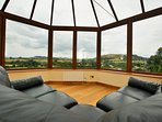 Relax in the conservatory and embrace the views