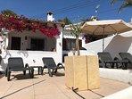 lower sunbathing area with terrace in background