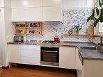 The modern kitchen of Gatsby on Watt Two Bedroom Apartment.