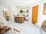Bright living area with equipped kitchenette