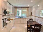 Large bright fully equipped kitchen