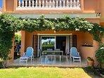 Beautiful terrace with new garden furniture overlooking large mature garden