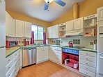 Double ovens, new stove, and modern appliances make home-cooking a breeze.