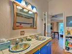 His-and-her Talavera sinks provide ample counter space for couples.
