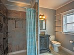 The ensuite master bath features a walk-in shower.