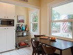Kitchen is bright and breezy - and features side entrance with BBQ grill access.