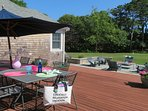 Relax on the back deck and enjoy dinner at the outdoor dining table - 29 Bellamy Lane North Chatham Cape Cod - New...