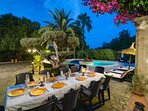 Evening Gardens and pool with Al fresco seating area for 14 people and 10 sun loungers