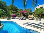 Gardens and pool with Al fresco seating area for 14 people and 10 sun loungers