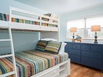 Second bedroom is family-friendly and sleep-over ready... with twin over full bunk beds.