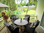 Large covered and private lanai overlooks garden, tennis and pool.  Perfect for 'dining out'.