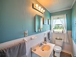 The bathroom is highlighted by vibrant blue walls.