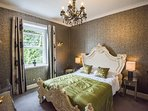 Room 6 with its impressive king size bed and large bathroom with bath and shower over.