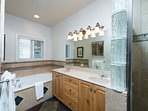 Attached master bathroom with jetted tub, separate shower, double vanity