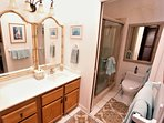 Master ensuite with separate walk-in shower and WC room.  Large skylights provide sunlight to area.