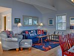 Nautical decor and soothing hues of blue fill the interior of this home.