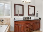 The master bathroom has double sinks, a soaking tub, a shower stall and a separate water closet.