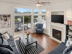 The sunken living room has plenty of seating, a large TV and a gas fireplace. You can also get some fresh air on the...