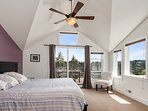 The bright master bedroom is located on the upper floor of the home.